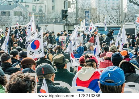 SEOUL South Korea March 18 2017: Protesters gather at a rally in central Seoul to demonstrate against the impeachment of Park Gun Hey