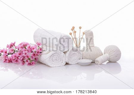 zen basalt stones and herbal ball, pink cherry on towel isolated