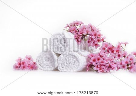 pink cherry on three rolled towel isolated