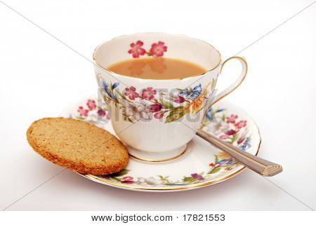 Cup of  Traditional English tea with biscuit on white background poster