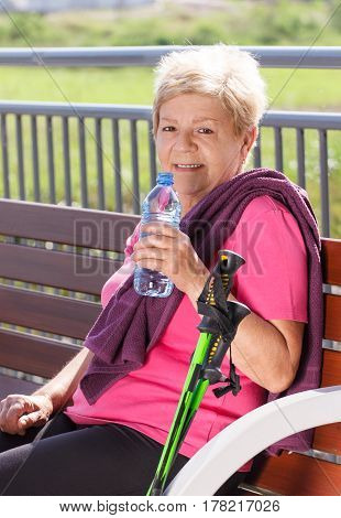 Senior Woman Resting After Nordic Walking, Sporty Lifestyles In Old Age