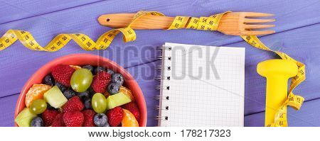 Fruit Salad, Centimeter With Dumbbells And Notepad For Writing Notes, Healthy Lifestyle And Nutritio