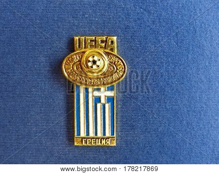 USSR - CIRCA 1984: Badge with the image ball and flag Greece, the inscription