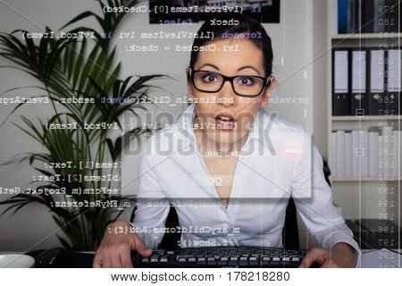 young computer programmer running into an unexpected error. the code she is working on can be seen through the screen.