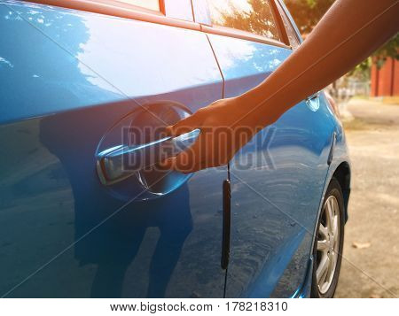 The gesture by hand to open the car doors.