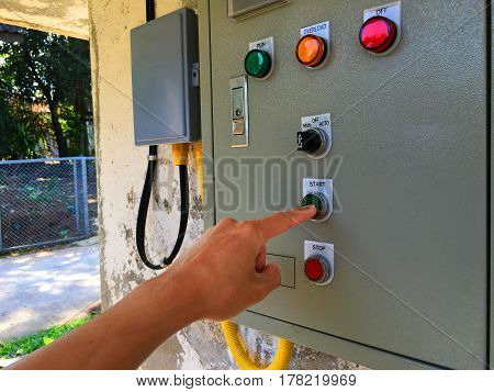 use hand is adjust switch on Electrical control cabinet at stick wall.