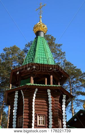 Bell tower of wooden Russian Orthodox Christian Church of Holy Royal Martyrs in Ganina Yama Monastery on early Spring, Ekaterinburg, Russia.