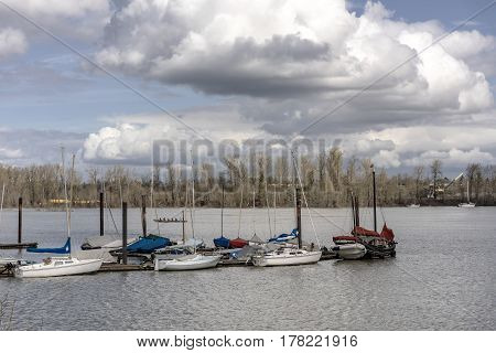 Sailboats and stormy clouds over the Willamette river in Portland Oregon.
