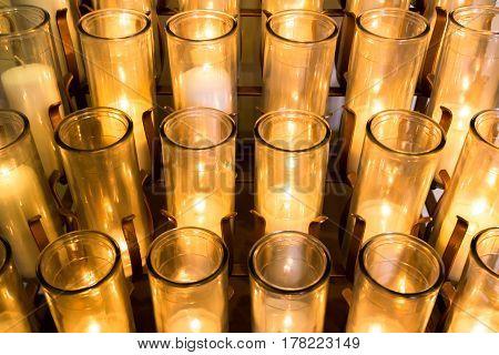 Rack of Many Beautiful White Votive Candles