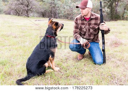 Portrait of Young Man Hunting With Dog
