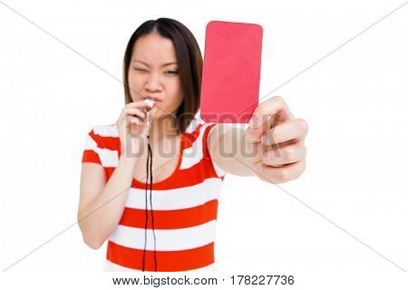Young woman whistling and showing red card on white background