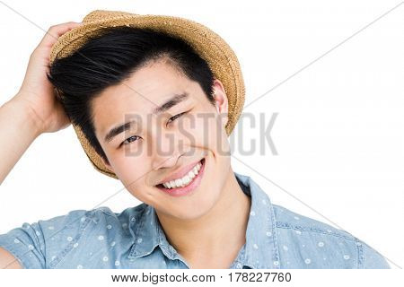 Close-up of young man smiling at camera on white background