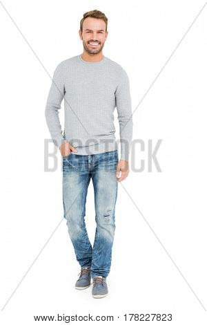 Young man standing with hands in pocket on white background