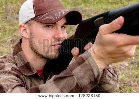Close up Young Man Hunting With Shotgun