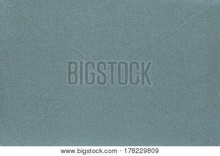 abstract speckled texture and background of textile material or fabric of pale turquoise color