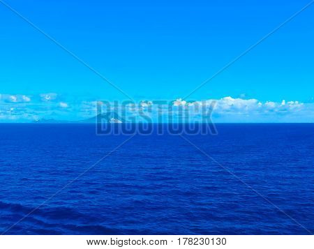 The small tropical island in the blue Caribbean sea