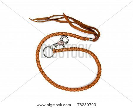 Brown leather belt woven in white, crafted on a white background. Soft focus.