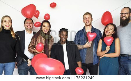 Happiness group of people with love heart shape balloon