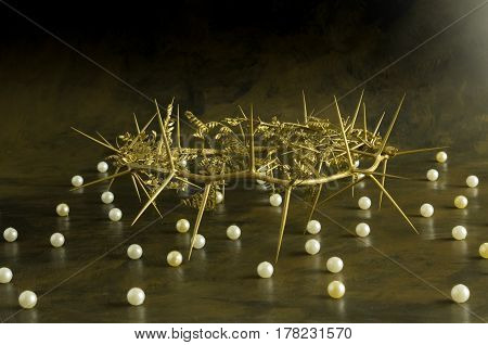 Gold thorn crown with pearls on grunge background