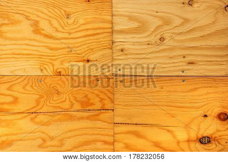 Wooden planks background four hardwood boards tiled and nailed with screws