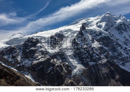 High Altitude Mountain View with large Glaciers flowing down to deep Canyon in Nepal Himalaya