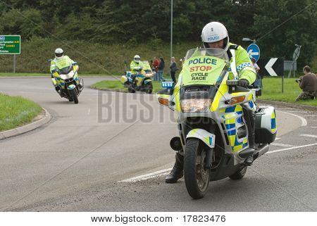 TELFORD, UK - SEPTEMBER 10: Tour of Britain Cycle Race - Police Stop the Traffic as the Riders Come Through Newport, September 10, 2008