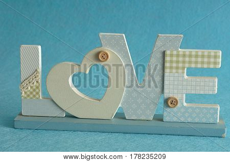 Valentine's Day. Love in blue letters isolated on a blue background