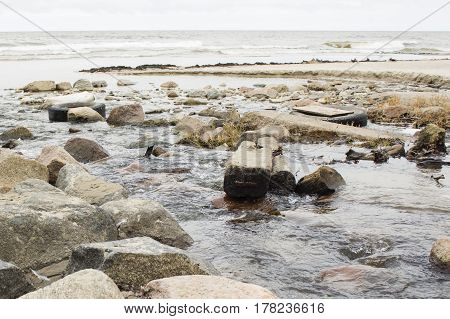 A polluted river flowing into the World Ocean. Environment protection.
