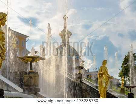 View of gilded fountains of the Grand cascade Peterhof Palace in Sunny day on blue sky background. The Palace of Peterhof, near St. Petersburg, fall 2015.