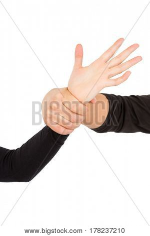 Close-up of hand holding wrist on white background