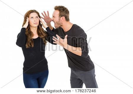 Young couple into an argument on white background