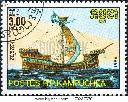 UKRAINE - CIRCA 2017: A postage stamp 3.00R printed in Cambodia shows old sailing ship cog series Medieval Ships circa 1986