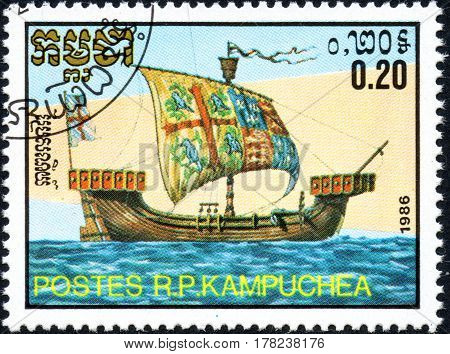 UKRAINE - CIRCA 2017: A postage stamp 0.20R printed in Cambodia shows old sailing ship English cog series Medieval Ships circa 1986