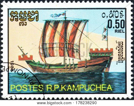 UKRAINE - CIRCA 2017: A postage stamp 0.50R printed in Cambodia shows old sailing ship cog series Medieval Ships circa 1986