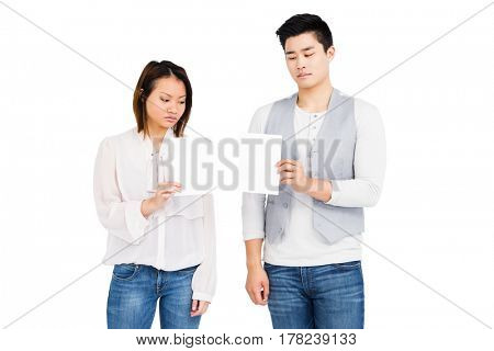 Worried couple looking at bill on white background