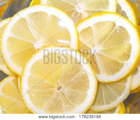 Looking at slices of juicy lemon felt its freshness taste and aroma