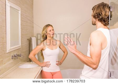 Upset couple having an argument in the bathroom