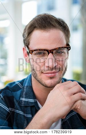 Handsome man working in a bright office