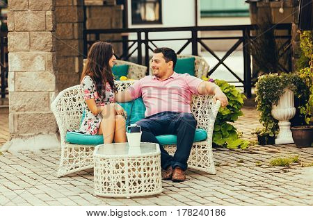portrait of attractive young couple in love outdoors