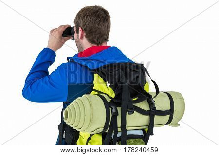 Side view of backpacker looking through binoculars on white background