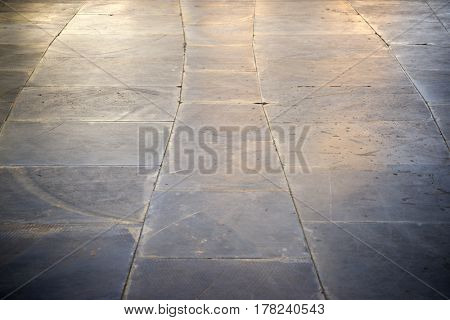Floor of a street with stone tiles.