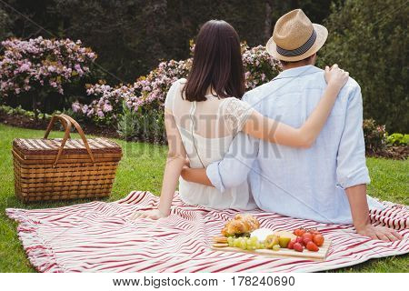 Rear view of young couple embracing each other in garden