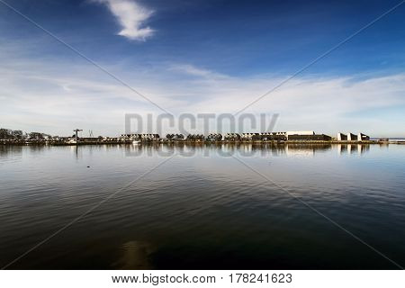 View from Assens harbor. Modern design summer townhouses skyline by the sea.