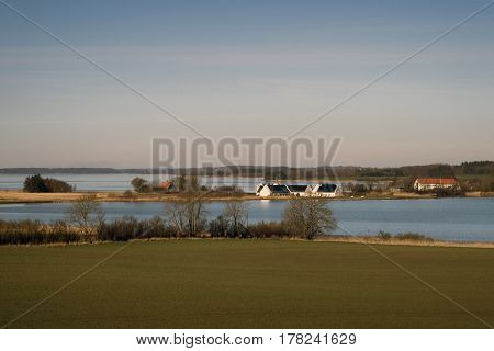 Danish springtime landscape. View from Fons church. Gamborg Fjord in the background.