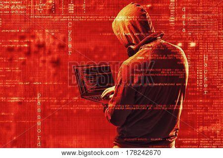 Internet Crime Concept. Dangerous Hacker, In Hoodie Shirt And Dark Red Digital Background Around, St