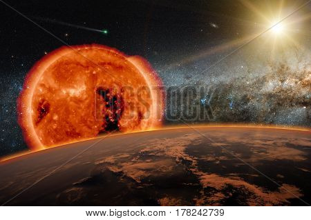 Old Sun over the dark planet Earth. A new star is born in the universe. A comet runs in the space.