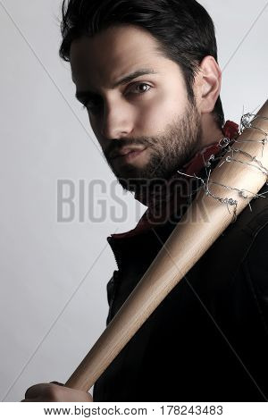 Handsome man holding a baseball bat on a white background