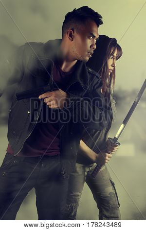 Book cover - two people running with weapons