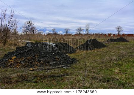 Pile of pulp in the field. Waste from the processing of granite in the workshop of stone processing.