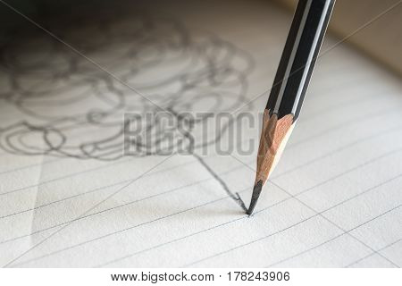 pencil draws a straight line on a paper note success concept.